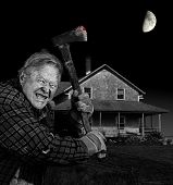 pic of gash  - Crazy old man with axe in front of old cedar wood shingle farm house black and white - JPG