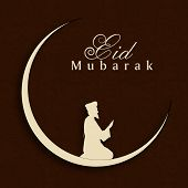 picture of namaz  - Eid Mubarak concept with silhouette of Muslim man praying  - JPG