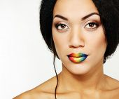 Beauty portrait of beautiful young mulatto fresh woman with rainbow lipstick, detail of face and sho