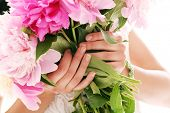 Beautiful bouquet of rose peonies in woman's hands
