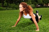 Beautiful middleaged caucasian woman working out in a park