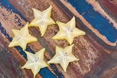 Five Stars Of Carambola On Wooden Table