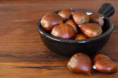 Chestnut In Black Bowl On Wooden Table