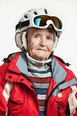 Portrait of senior woman in ski jacket and helmet