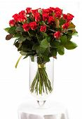 Bouquet of red roses over white