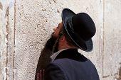 Orthodox Jewish Man prays at the western wall, Jerusalem