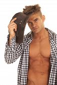 Man With Open Shirt Hold Hat By Head