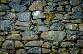 stock photo of old stone fence  - Background Texture Of An Ancient Rustic Stone Wall - JPG