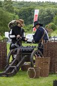 History Fans Dressed As 17Th Century Mercenary Soldiers Load Historical Cannon At A Free Public Reen