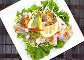 Hot and spicy steamed fish in lemon sauce