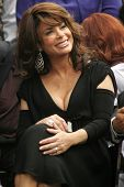 Paula Abdul at the Ceremony Honoring Los Angeles Lakers Owner Jerry Buss with the 2,323rd star on the Hollywood Walk of Fame. Hollywood Boulevard, Hollywood, CA. 10-30-06