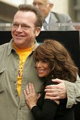 Tom Arnold and Paula Abdul at the Ceremony Honoring Los Angeles Lakers Owner Jerry Buss with the 2,323rd star on the Hollywood Walk of Fame. Hollywood Boulevard, Hollywood, CA. 10-30-06