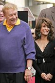 Jerry Buss and Paula Abdul at the Ceremony Honoring Los Angeles Lakers Owner Jerry Buss with the 2,323rd star on the Hollywood Walk of Fame. Hollywood Boulevard, Hollywood, CA. 10-30-06
