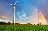 picture of wind-farm  - Wind power plant - eco energy with rainbow