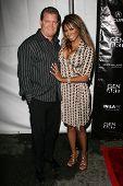 John Edward Yarbrough and Traci Bingham at the Gen Art 9th Annual Fresh Faces in Fashion event, Barker Hanger, Santa Monica, CA 10-13-06