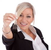 Real Estate Agent With Keys Over White Background