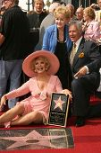 Ruta Lee with Debbie Reynolds and Alex Trebek at the award ceremony honoring Ruta Lee with a star on the Hollywood Walk of Fame. Hollywood Blvd., Hollywood, CA. 10-10-06