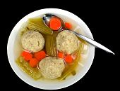 image of matzah  - Matzo ball soup on a black background - JPG