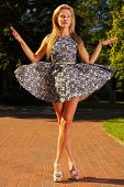 Fashion Young Woman In Park Stylized Like Marionette