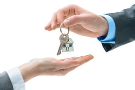 image of possession  - Man is handing a house key to other hands - JPG