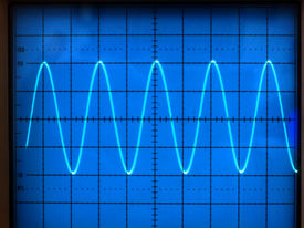 stock photo of electrical engineering  - electrical signals displayed on the screen of an oscilloscope - JPG