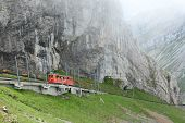 ALPNACHSTAD, SWITZERLAND - July 3, 2014: The Pilatus-Bahn, the world's steepest cogwheel railway nea