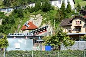 ALPNACHSTAD, SWITZERLAND - July 3, 2014: The Pilatus-Bahn, the world's steepest cogwheel railway takes passengers to the summit of Mt. Pilatus with spectacular views of the Lucern Valley.