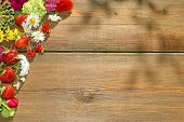 Summer Flowers And Berries On Grunge Wood Table