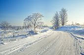 Winter Landscape With The Road, Forest And The Blue Sky