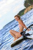 Happy Windsurfer Sitting On The Board