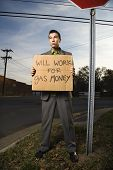 Businessman Holding Gas Money Sign