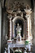 RIOMAGGIORE, ITALY - MAY 02, 2014: Altar of the Virgin Mary with Child in the Saint John the Baptist