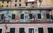 RIOMAGGIORE, ITALY - MAY 02: one of the Cinque Terre villages, UNESCO World Heritage Sites, Murals o