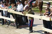 LYTKARINO, MOSCOW REGION, RUSSIA - JULY 12, 2014: Spectators and the staff in cossack's uniform watching Russian championship in trick riding. Lytkarino housed the Russian Federation of trick riding