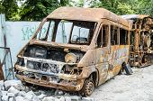 stock photo of collapse  - Old rusty bus partially collapsed in the backyard - JPG