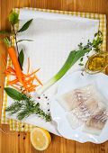 Cod fillets with vegetables before cooking in parchment paper
