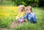 Two Cute Little Girls On Nature