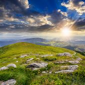 Light On Stone Mountain Slope At Sunset