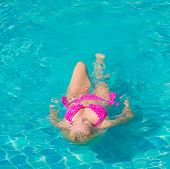 Graceful Relaxing In a Blue Pool