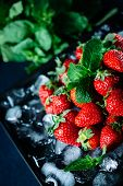 Ripe Strawberry On Ice With Mint