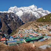 stock photo of sherpa  - The Himalayan settlement of Namche Bazaar an important sherpa village along the Everest Base Camp Trek in Nepal - JPG