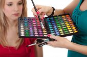Make-up Girl Showing Range Of Collors