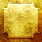 Golden metal nameplate. Industrial background