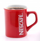 Ankara, Turkey - May 31, 2012: Studio shot of a red Nescafe cup isolated on white background.