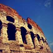 picture of the Flavian Amphitheatre or Coliseum in Rome, Italy, with a retro effect