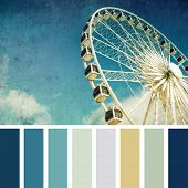 A ferris wheel, vintage style,  in a colour palette with complimentary colour swatches