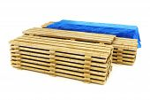 stock photo of 2x4  - Stacks of wood building lumber on a white background - JPG
