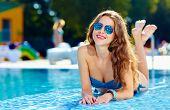 Beautiful Girls Lying Near Swimming Pool