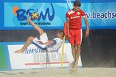 MOSCOW, RUSSIA - JULY 13, 2014: Theofilos Triantafyllidis of Greece performs the bicycle kick in the match with Belarus during Moscow stage of Euro Beach Soccer League. Belarus won 6-5