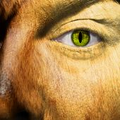 stock photo of werewolf  - A man changing into a werewolf with slit pupil - JPG